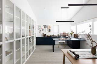 A light-filled office has plenty of built-in storage.