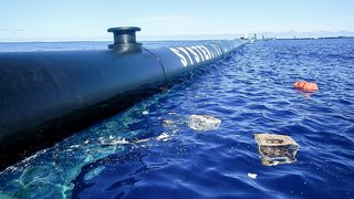"Dubbed ""System 001,"" The Ocean Cleanup's initial design sweeps the ocean's surface for floating debris."