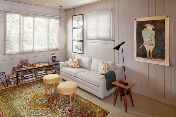 A light-filled corner nook offers an idyllic setting for reading and relaxation.