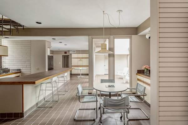 Upon entering the home, guests are welcomed to a spacious, open-plan kitchen and dining area.