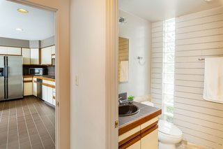 One of the home's three bathrooms is conveniently located right off the kitchen.