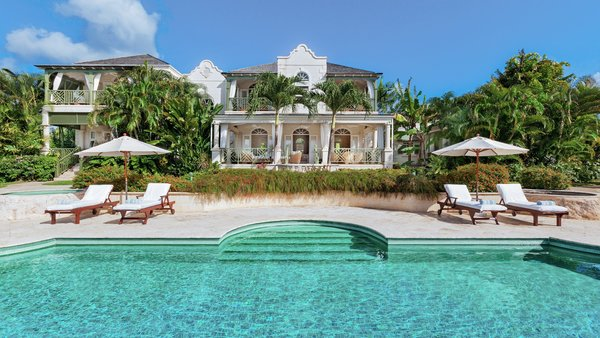 Go Easy in Mount Standfast lies in the Sugar Hills gated community in Barbados. It has the only private tennis court on the block, and it also comes with a gazebo, cottage, and poolside pavilion with a wet bar and barbecue.