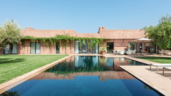 Villa Agar in Marrakesh, Morocco, is surrounded by gardens, olive trees, and sculptures. The designer villa sits within the Royal Fairmont Palm Resort.