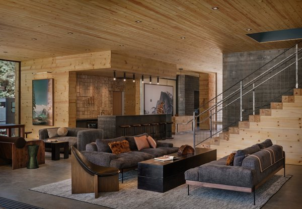 The clubhouse's palette of cool concrete, pine, and steel makes rustic refined. The assortment of seating in the clubhouse's main area allows guests to occupy every space, but it still feels intimate with one or two people.