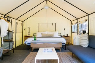 Tent suites are similar in tone to the Airstreams, but offer a more outdoorsy glamping experience. The central pendant light is by In Common With.