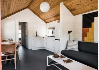 The cabins are holdovers from when the site used to be a KOA; Geremia Design renewed the interiors.