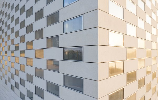 The facade is composed of 4,800 concrete slabs interspersed with glass.