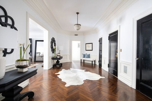 Sited at the corner of Park Avenue and 77th Street, the 3,025-square-foot apartment features an elongated, octagonal foyer with 10-foot-high ceilings and lustrous, herringbone-pattern original hardwood floors.