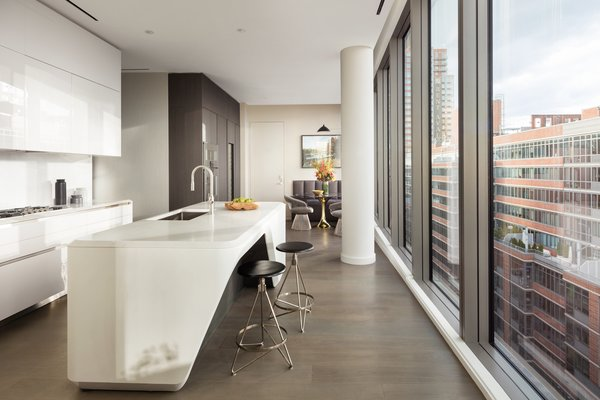 The expansive eat-in kitchen by Boffi is well equipped with Gaggenau appliances.