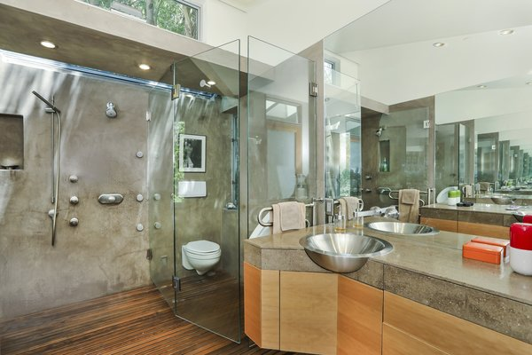 In the bathroom, generous windows and skylights create the illusion of an outdoor shower.