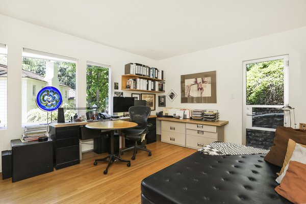 One or more of the four bedrooms could easily be converted into a home office or media center.