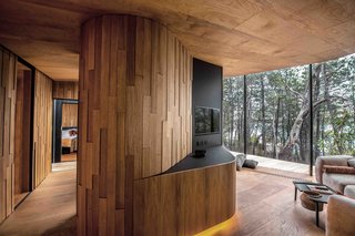 Offset planks of wood lend texture to interior walls.