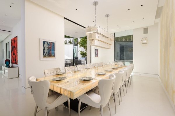 Pendant Lighting and Recessed Lighting Featuring a 32-light chandelier, the formal dining area can comfortably host 14 people.  Photo 5 of 14 in Actress Bette Davis's Former Beverly Hills Home Serves Up Hollywood Glam For $34.5M