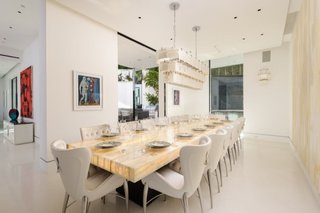 Featuring a 32-light chandelier, the formal dining area can comfortably host 14 people.