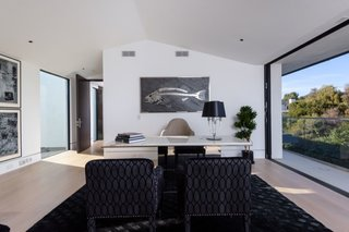 A chic, light-filled office is located on the upper level.