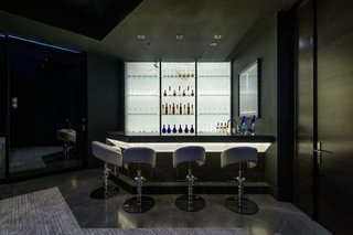 A full bar is located on the lower level, facilitating easy entertaining.