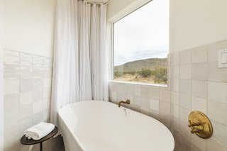 Breathtaking mountain views can be seen from the bathroom's large soaking tub.