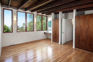 Exposed wooden beams and beautifully restored midcentury detailing create the illusion of stepping back in time.