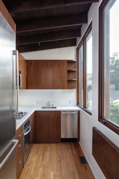 Although compact in size, the kitchen is well-equipped with new stainless-steel appliances.