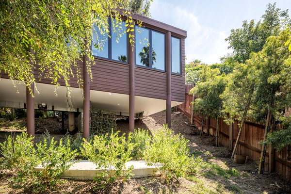 Perched on a 5,556-square-foot lot, the home offers a multitude of outdoor seating areas amongst a number of mature trees, providing a serene escape from the city.