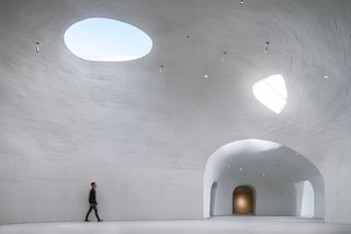 Spanning 10,000 square feet, the subterranean museum is comprised of 10 galleries (seven indoor and three outdoor), a cafe, and a reading room.