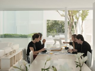 "Miguel and Ana sit down to a meal with their son, Rafael, and his wife, Fernanda. Rafael is a designer at his father's firm and Fernanda oversees communications. The house is part of a compound that includes an office for the design studio and two other residences that Miguel rents out for public events or to people who want to stay ""a day, a month, or a year."""