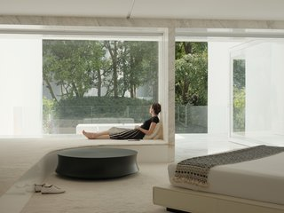 The master bedroom includes a table by Poliform.