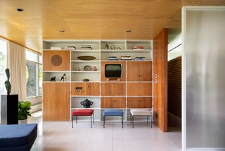 With the same materials that were used originally—like the mahogany and Douglas fir in the living room—Dominick and Scott sensitively restored the interior. Knoll fabrics cover the vintage Paul McCobb stools.
