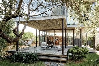 Buenos Aires–based architect and furniture designer Alejandro Sticotti combined clean lines and a handmade aesthetic at his beach house in Uruguay. The home is made up of two stacked boxes built from steel and board-formed concrete and wrapped in glass and tropical hardwood. Surrounded by a fence in the coastal town of La Pedrera, it is a sanctuary within a sanctuary.