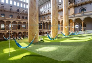 Hammocks allow guests to bask in the museum's sunny great hall.