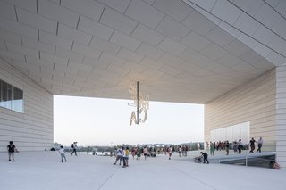 """Bjarke Ingels calls the hollow space at the center of the building an """"urban room,"""" which is meant to serve as a general meeting place for the public."""