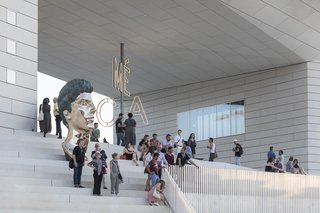 """""""Un Détail"""" by Benoît Maire sits on the steps of the newly opened center. Maire's work was chosen by the Regional Council of New Aquitaine in partnership with Artistic 1%, a state device that funds contemporary creativity in association with architectural works."""