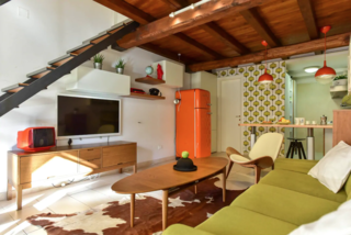 This colorful cottage (complete with garden, midcentury modern decor, and a spiral staircase) is located in the historical San Lorenzo neighborhood near Sapienza University. Bars, restaurants, and public transport abound in this bohemian locale.