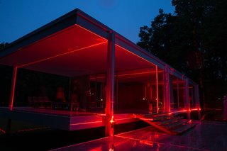 The red laser beams light the home at night, giving it a new, unique aesthetic.