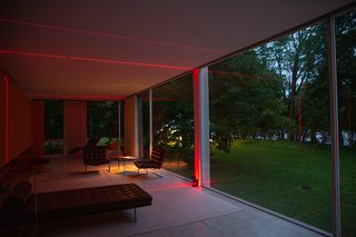 A view from inside Farnsworth House shows the laser beams at play with the surrounding environment.
