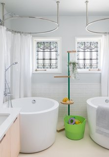 The Siglo Japanese soaking tubs in the girls' bathroom are from Signature Hardware.
