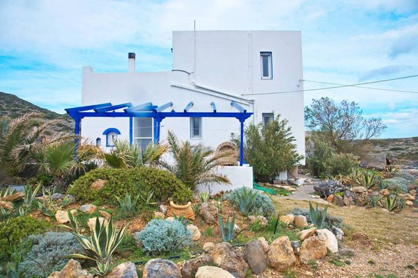 The mediterranean island is home to an array of succulents and chaparral. The white and blue buildings are a signature of the region.