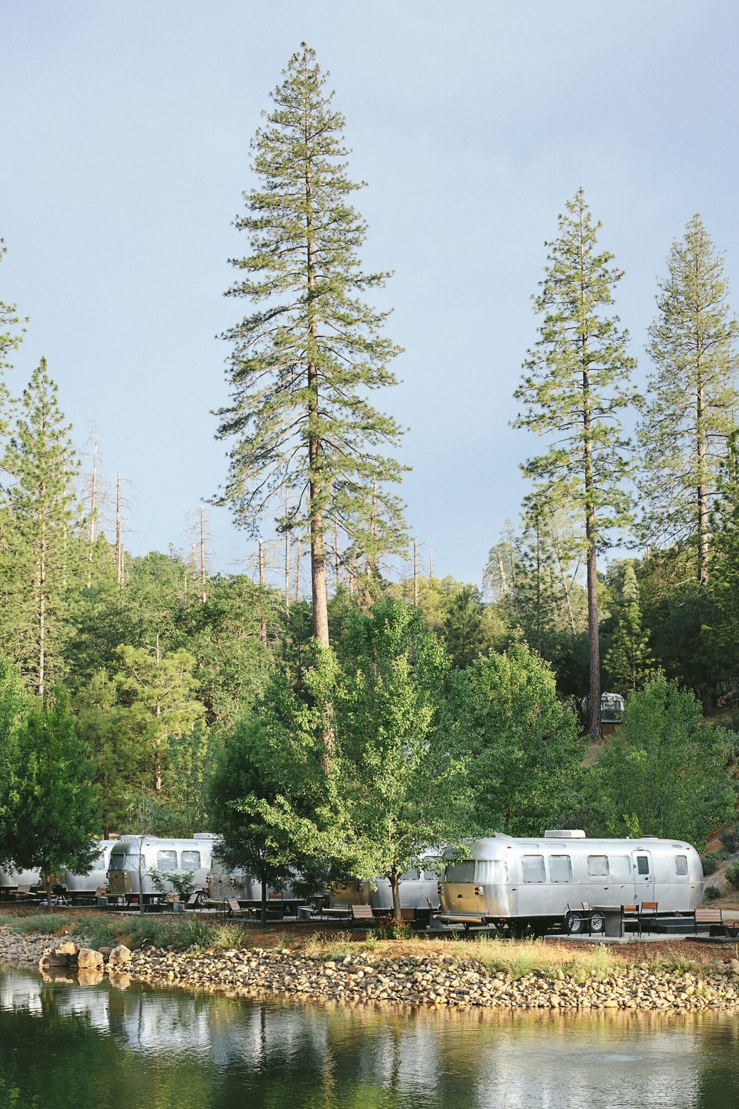 Exterior, Airstream Building Type, Metal Siding Material, and Metal Roof Material Our airstream suites looked out onto the natural pond at the center of the grounds. At night, most guest light up their fire pits to roast marshmallows and relax.  Best Photos from AutoCamp's Epic New Location Brings Upscale Airstream Lodging to Yosemite National Park