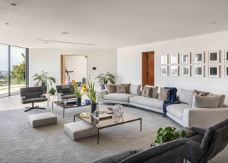 The large living room offers plenty of seating space. The neutral color scheme fosters a calming ambiance.