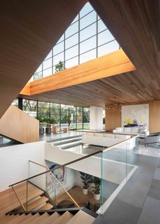 Expansive windows and skylights usher incredible amounts of natural light into the residence.
