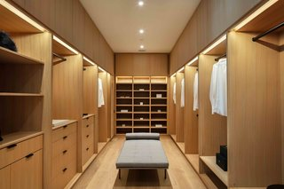 The master suite comes with dual walk-in closets, both of which offer custom built-in cabinetry.