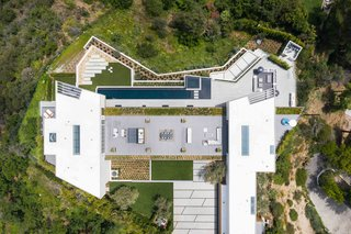 A look at the 20,000-square-foot residence from above. Here, you can see a clear view of the 2,000-square-foot rooftop terrace, as well as the 84-foot-long infinity pool.