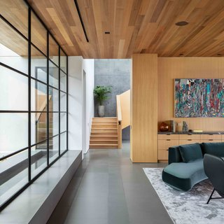 The exposed concrete is thoughtfully balanced with warm wood and minimalist details.