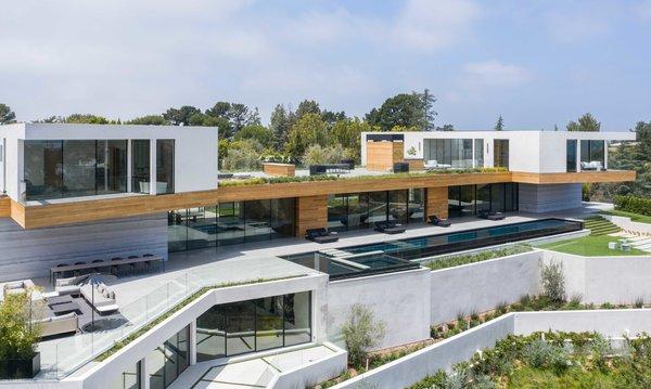 The expansive estate sprawls over several terraced levels.
