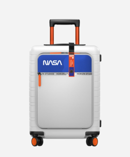 The redesigned, special-edition M5 cabin luggage is Apollo white with NASA's blue and orange trim.