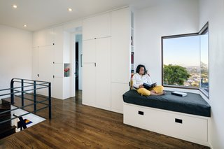 Jennifer Weiss Architecture designed a custom storage unit and reading nook, which also enjoys a corner window.