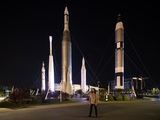Drift artist Ralph Nauta poses in front of NASA's Rocket Gardens at the Kennedy Space Center in Florida.