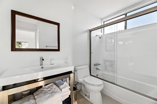 The master bedroom features an updated ensuite bathroom, with another full bathroom available for the second bedroom.