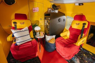 Two plush captain seats sit near the rear of the vehicle. A mini fridge comes stocked with Oscar Mayer hot dogs, condiments, and other essentials for a proper summer barbecue.