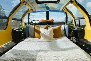 The retrofitted interior lets guests nestle inside the giant bun—like a hot dog—as they sleep.